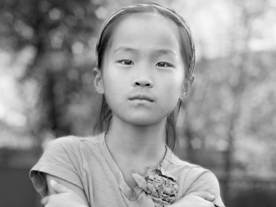 young asian girl looking at the camera